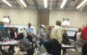 Residents stand against the widening
